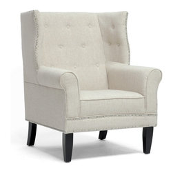 Wholesale Interiors - Kyleigh Beige Linen Modern Arm Chair - A modern update looks good on our Kyleigh Chair! This drool-worthy design takes elements of a traditional wingback arm chair and mixes them with neutral linen and a few modern twists to fit snugly in your modern living room. Our Chinese craftsmen build a sturdy wooden frame with black legs, add firm foam cushioning, and finish it off with beige linen upholstery. Silver upholstery tacks and button accents dress it up. Please note the seat cushion is not removable and non-marking feet are included. Minor assembly is required. Please spot clean only. The Kyleigh Modern Club Chair is also available in dark gray linen (sold separately). Seat dimensions: 19 inches high x 20 inches wide x 22.5 inches deep. Overall Dimensions: 42.5 inches high x 33 inches wide x 34 inches long.