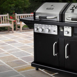 Fall 2012 - This duel fuel (LP gas and charcoal) grill offers a total of 934 square inches of total cooking space. The LP gas grill has two 15,000 BTU stainless steel P shaped burners for 30'000 BTU's of gas cooking power covered with an enameled steel heat tent that protects the burners and vaporize falling juices that flavor food. There is also a 12,000 BTU side burner built-in on one side shelf. The charcoal grill offers an adjustable charcoal tray for cooking flexibility and has a 12,000 BTU electronic ignition burner that eliminates the need for use of lighter fluid. The charcoal side is also equipped with a large capacity ash pan that's easily accessible from the front of the grill for quick cleaning. The lid assembly consists of a double-wall stainless steel sleeve for use of heat retention, a temperature gauge and an easy grip lid handle. The easy to clean enameled cast iron cooking grates retain heat to sear foods and lock in flavorful juices. Enameled wire warming racks providing plenty of additional space for cooking or keeping food warm.
