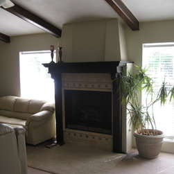 Add a Gas Fire Place - Stain & polyurathane mantle woods to match ceiling beams......