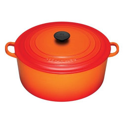 Le Creuset - Enameled Cast Iron 9-Qt. Round Dutch Oven - For generations, families have come to cherish this everyday French Oven (or Dutch oven, referred by most people). Ideal for simmering, marinating, poaching, braising, and browning; this piece moves from the stove or oven to the table and can store leftovers in the refrigerator or freezer! Features: -Dutch oven.-Material: Enameled Cast Iron.-Shape: Round.-Enhanced handles are 45% larger, distributes the weight evenly and easier to grip when wearing oven mitts.-Lid traps heat and seals in flavor and moisture.-Phenolic knob is oven safe to 480°F.-Evenly spreads heat.-Longer retains heat.-Ideal to use when making soups, rice dishes, casseroles, roasts, quiches, one pot meals, baked recipes, desserts, cakes and breads.-Works well on all heat sources, including induction and oven safe.-Refrigerator and freezer safe.-Dishwasher safe, recommended Hand washing.-Capacity: 9-Qt..-Provides even heat distribution and superior heat retention; colorful exterior enamel resists chipping and cracking.-Advanced sand-colored interior is durable, makes it easy to monitor food as it cooks to prevent burning or sticking.-Collection: Enameled Cast Iron.-Distressed: No.-Country of Manufacture: France.Dimensions: -Overall Product Weight: 18 lbs.Warranty: -Lifetime limited warranty.