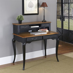 HomeStyles - Oak and Rubbed Black Student Desk and Hutch - The student desk is constructed of poplar solids, engineered wood and oak veneers in a distressed oak and heavily rubbed black finish. The distressed oak features several distressing techniques such as worm holes, fly specking, and small indentations. Features include four storage drawers, one center shelf, and cable access through hutch. Design features include shaped carved proud legs, corner peg accents, and detailed brass hardware. Assembly required. 42 in. W x 24 in. D x 40 in. H