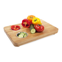 Professional Chopping Board - Chop your ingredients like a pro with this Professional Chopping Board.  Not only is the bamboo board itself thick, spacious, and easy to use, but it comes with two built-in bowls for easy ingredient storage.  Simply scoop chopped ingredients into the bowls to keep them separated and ready for adding to your dish when the time comes.