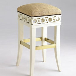 Jan Showers Coco Counter Stool - This lovely stool is intricate yet contemporary. The carved cut-outs and brass foot rail are details that make it a unique stand out.