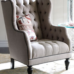 "Air Mail Tufted Chair - Sink in to this deeply tufted wingback chair.  It will envelop you and quickly become your favorite spot to curl up with a good book.  You'll love it modern styling with contrasting piping for a stylish look.31""W x 39.5""D x 44""T."
