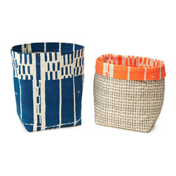 Canvas Storage Bins - Keep pens, pencils and other odds and ends organized with some sharp-looking canvas containers.