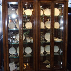"Henredon Double Full Glass China Cabinet - This is a fabulous carved double curio or china cabinet by Hendredon. The cabinet has full glass sides and double doors, mirrored back and 8 glass shelves.  Measurements: 67"" wide x 16"" deep x 84.5"" high."