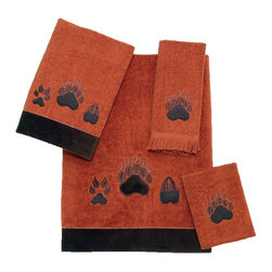 Avanti Linens - Paw Prints 4 Piece Cotton Towel Set by Avanti Linens - Paw Prints realistically recreates the paw prints of various forest creatures with a brown and black embroidery. The bath and hand sizes are trimmed with a coordinating brown fabric border. The primary color of the towels is copper.