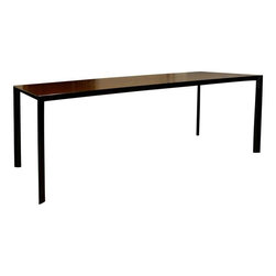 Pre-owned Italian Porro Ram Dining Table - Italian Ram Dining Table by Porro with top made of Mongoi wood and supported by black lacquer legs. Sleek and luxurious, this elegant dining table is at home paired with contemporary or transitional accents.