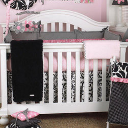 Cotton Tale Designs - Girly Bumper - A quality baby bedding set is essential in making your nursery warm and inviting. All Cotton Tale patterns are made using the finest quality materials and are uniquely designed to create an elegant and sophisticated nursery. What could be cuter than this adorable set Girly, in pink and black. The bumper is a combination of big floral black pin dot and bias stripe black & white trimmed in a bright pink ruffle. Long sides of bumpers are 52x11 and short sides are 26x11. This is a smashing nursery for your baby girl. 100% cotton twill. Wash gentle cycle, separately in cold water. Tumble dry low or hang dry.