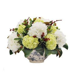 Winward Home - White Christmas Hydrangea - A breath-taking marriage of colors for a very merry white Christmas. Snowy white hydrangeas highlighted by soft shades of green and an inlay of red berry sprays for a magnificent combo!