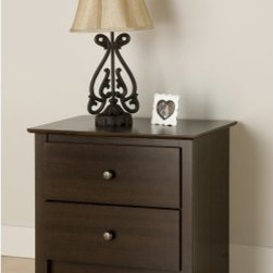 "Fremont 2-Drawer Night Stand - Espresso - The Fremont 2-Drawer Night Stand - Espresso has a stylish bedside manner. Providing plenty of room for your bedside reading material this two-drawer nightstand will enhance any bedroom decor. Accented with antique bronze-finished knobs this nightstand features a smooth profiled top and arched kick plate. Smooth metal roller guides ensure that the drawers easily glide open. Built-in safety stops prevent accidental spilling. Crafted of durable composite woods in an attractive espresso finish this nightstand comes ready-to-assemble and has no plastic edge-banding. Dimensions: 23.25W x 16D x 21.75H inches. Fremont bedroom collection pieces can match all espresso beds and headboards.About Prepac ManufacturingPrepac is a successful designer and manufacturer of functional and stylish RTA (ready to assemble) home furniture. They have been manufacturing state-of-the-art home furnishings and storage products in the heart of the forest-rich West Coast since 1979.To ensure that customers receive the highest quality products Prepac's design engineering production testing and packaging are all performed in-house. Each component of every product is carefully engineered to be produced with minimal handling without compromising quality function and value. Prepac's state-of-the-art materials management system tracks every component from cutting through to packaged goods inventory support and fulfillment to final delivery.Most of Prepac's RTA products are made from a combination of """"engineered woods."""" Engineered Wood is a mixture of high quality hard and soft wood materials which generally come from the surplus of original lumber processing. These materials are bonded together with a synthetic resin in a process under high heat and pressure to make a very stable environmentally friendly product. The result is dense strong panels which are then laminated with durable attractive finishes."