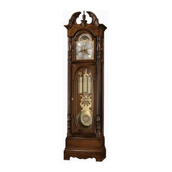 Howard Miller - Howard Miller - Robinson Floor Clock - Dramatize your room's decor with this tall, dark and handsome special edition grandfather clock defined by a commanding presence, luscious Cherry Bordeaux finishings, a kaleidoscope of select hardwoods and veneers, movable levers and other elemental craft details. * This 79th Anniversary Edition floor clock features rare bookmatched olive ash burl, a turned finial, and a carved shell overlay which draws attention to the elegant swan neck pediment. Olive ash burl corner overlays frame the crystal-cut oval glass on the lower door, providing a striking view of the pendulum and weights. . The polished-brass dial, specially inscribed through 2005, offers elaborate corner spandrels, a center disk, and a silver chapter ring with applied brass Arabic numerals. An astrological moon phase dial is also featured. . The polished-brass pendulum includes a center disk that complements the dial and coordinates with the banded, polished-brass weight shells. . Elaborately carved, reeded columns with turned top and bottom caps and carved oval appliques enhance the front view of the clock. The multitiered base features a decorative cutout. . Removable beveled glass top side panels allow easy access to the movement. The side lower glass is also beveled. . Cable-driven, triple chime Kieninger movement offers automatic nighttime chime shut-off option. . Finished in Cherry Bordeaux on select hardwoods and veneers. . Adjustable levelers under each corner provide stability on uneven and carpeted floors. . You will receive a free heirloom plate, engraved with name and date, by returning the enclosed request card to Howard Miller. . Locking door for added security. . Automatic nighttime chime shut-off option. . Manufacturer's 2 Year Warranty. 86-1/4in (219 cm) H x 23in (58 cm) W x 13-1/2in (34 cm) D