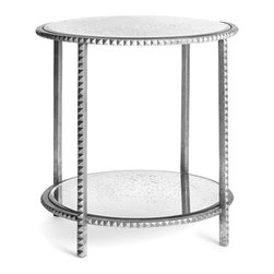 Kathy Kuo Home - Round Silver Leaf Studded End Table with Antique Mirror - This piece has a certain type of luxurious rock and roll attitude.  Kind of like a Rick Owens jacket -  edgy, but something that feels especially good in Paris.  This small, mirror topped end table delivers a serious dose of edge without going completely over the top.