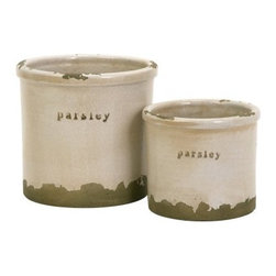 Parsley Sage Pots - Set of 2 - The Parsley Sage Pots - Set of 2 brings wild herbs out of the garden and into your home. Constructed from durable red clay, these two herb pots are kiln fired and finished with a white crackle glaze that enriches their texture. The unfinished, rough edges are exposed to further the aged aesthetic.About IMAXWhat began as a small company importing copper flower containers in 1984 by Al and Faye Bulak has developed into one of the top U.S. import companies serving the At Home market today. IMAX now provides home and garden accessories imported from twelve countries around the world, housed in a 500,000 square foot distribution center. Additional sourcing, product development and showroom facilities in the USA, India and China make IMAX a true global source. They're dedicated to providing products designed to meet your needs. This is achieved through a design and product development team that pushes creativity, taste and fashion trends - layering styles, periods, textures, and regions of the world - to create a visually delightful and meaningful environment. At IMAX, they believe style, integrity, and great design can make living easier.