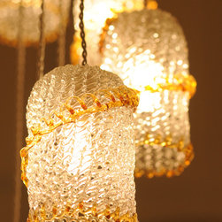 Sarug - The hand blown Sarug pendant has a lacy look created by crisscrossing threads of glass in a net pattern.
