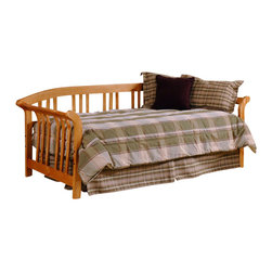 Hillsdale - Hillsdale Dorchester Solid Wood Daybed-Daybed with Roll-Out Trundle - Hillsdale - Daybeds - 1104DBLHTR - The Hillsdale Dorchester Daybed is constructed of solid pine with a warm friendly country pine finish. It features sleigh arms with curved slat spindles with a gently sloped backrest. The beautiful light wood finish will complement your decor in any room. This twin size daybed includes a mattress supporting suspension deck for your convenience. Extend its versatility by using it as a sofa in the home office or combining it with the optional roll-out trundle in the guest room for even more sleeping space. The concealed space saving optional roll-out trundle includes six casters for easy setup and supports a standard twin size mattress. With calming curves and mission styling the Dorchester Daybed is sure to make any room in your home inviting and comfortable.