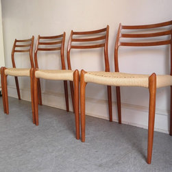 Set of 4 J.L. Moller teak dining chairs, model #78 - Beautiful set of 4 vintage teak dining chairs. These elegant chairs were designed by Niels Moller in 1962 and made in Denmark by J.L. Moller. These have all new Danish paper cord seats.