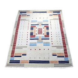 Used Vintage Wool Flatweave Rug - Vintage flat-woven wool rug, likely a Turkish kilim, with a very cool modern, geometric design. The ground is a neutral ivory and the design is comprised of navy blue, salmon, Carolina blue, brick red, pale yellow, and taupe/greige blocks in varying sizes. The ends have short cotton fringe that is in great shape and the sides are serge-bound. This rug has just been professionally cleaned, however, there are some faint stains. There is also one repair area. See photos for details.