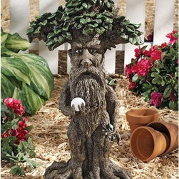 Design Toscano - Design Toscano Treebeard Ent with Mystical Orb Statue Multicolor - DB383066 - Shop for Sculptures Statues and Figurines from Hayneedle.com! Your own Treebeard to protect your part of the forest. The Design Toscano Treebeard Ent with Mystical Orb Statue is perfect for any Lord of the Rings fan. It's artistically carved from designer resin and has amazing detail. Treebeard and his orb are hand-painted and designed to weather the elements beautifully.About Design ToscanoDesign Toscano is the country's premier source for statues and other historical and antique replicas which are available through the company's catalog and website. Design Toscano's founders Michael and Marilyn Stopka created Design Toscano in 1990. While on a trip to Paris the Stopkas first saw the marvelous carvings of gargoyles and water spouts at the Notre Dame Cathedral. Inspired by the beauty and mystery of these pieces they decided to introduce the world of medieval gargoyles to America in 1993. On a later trip to Albi France the Stopkas had the pleasure of being exposed to the world of Jacquard tapestries that they added quickly to the growing catalog. Since then the company's product line has grown to include Egyptian Medieval and other period pieces that are now among the current favorites of Design Toscano customers along with an extensive collection of garden fountains statuary authentic canvas replicas of oil painting masterpieces and other antique art reproductions. At Design Toscano attention to detail is important. Travel directly to the source for all historical replicas ensures brilliant design.