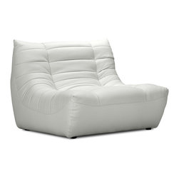 Zuo Modern - Carnival Single Seat White - Like curling up in someone's arms, the Carnival sectional set is wrapped in a soft leatherette, padded and tufted in all the right ways. Comes in espresso, black and white.