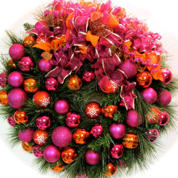Bright Christmas Wreath, Pink and Orange by Sandy Newhart Designs - This wreath is full of sparkle and nontraditional colors. It would be perfect layered over a mirror in a girls' bedroom.