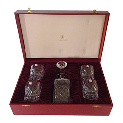 """Pre-owned Tudor Lead Crystal Decanter & Highball Set - This large set of English leaded crystal by Tudor includes a decanter with a stopper and four high-ball glasses and comes in a custom box lined with burgundy fabric. The decanter measures 10""""H x 3.5""""W while the glasses measure 3/5W x 3.75H. The crystal is very heavy and deeply cut throughout. It appears to have never been used as there are still stickers on each of the pieces. The box is burgundy red with gold accent lines on the top."""