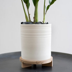 Striped Planter + Tripod Stand - This is simple design done right. The little tripod stand is such a sweet touch, and the banding around the top of the planter adds just the right amount of detail.