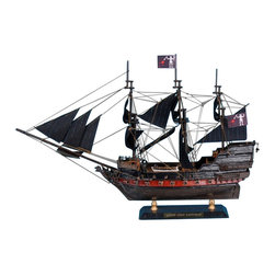 Handcrafted Nautical Decor - Blackbeard's Queen Anne's Revenge Limited 15'' - Blackbeard's Pirate Ship - Dec - --SOLD FULLY ASSEMBLED--Ready for Immediate Display - Not a Model Ship kit�--The famous Blackbeard's Queen Anne's Revenge Limited 15'' is a highly detailed Pirates of The Caribbean model ship.   Search  for lost treasure as you set sail for adventure on the high   seas aboard  this scale tall model ship replica.�This unique pirate boat is highlighted by fine  craftsmanship and   attention to detail. Place this on a shelf, mantle, or desk to add a   decorative pirate touch.��--15'' Long x 4'' Wide x 10'' High------    Built from      scratch by      our master artisans--    Accurate scale model replica of the Queen�Anne's Revenge --    --    Detailed Features Include:���� ������������������������������������������������������������������������������ --    --        12 pin stripe black sails �������� --        Hand-painted traditional pirate colors black, and grey--        Two metal anchors attached to each side of boat--        Authentic scale lifeboat with oars --        Unique skull pirate figurehead--        Miniture lantern hangs from brass chain on back of boat--        Pirate flags hang along the masts of the ship ������������������ --        --    --    --    Metal nameplate attached to wooden base to identify the boat as the Queen Anne's Revenge--    ----