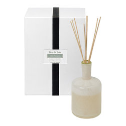 Feu De Bois / Ski House Diffuser - 15 oz. - Fog-colored glass gives a reserved beauty to the bottle that holds the fragrance oil for the Feu De Bois Diffuser.� Its Ski House scent is wintry, bracing, yet rich and warm, infused with the comfort of wood smoke and the imaginative chill of mountain spruce.� Recall nights by the fire of a favorite vacation getaway every time you reverse the reeds in this high-end fragrance diffuser.