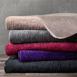 Madison Park - Madison Park Quilted Glimmersoft Throw - Glimmersoft is the ultimate shimmer plush. The nature of the fabric allows for an added sheen, producing a luxurious plush throw. The throw features polyester satin trim and is filled with polyester for extra loft. Face & Reverse: solid glimmersoft, brushed one side, 100% polyester, 280gsm Binding: 100% polyester satin Lining: 100% polyester non-woven Filling: 100% polyfill, 60gsm