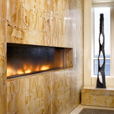 Modern Indoor Fireplaces by Water Studio