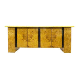 "Milo Baughman - Pre-owned Milo Baughman Burled Wood Bar Cabinet - Party at your place! You'll be hosting an ""American Hustle"" themed shindig just in order to showcase this spectacular 1970s bar cabinet by Milo Baughman. It features a pair of cabinets flanked by pull out shelving compartments intended for bottles or glasses. The burled wood finish is outlined on top by a thin ebony band while wider vertical bands separate each of the front sections."