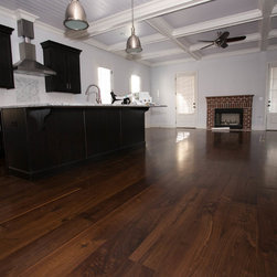 """Black Walnut Plank Flooring - This 8"""" wide Black Walnut Plank Floor was made using Sustainably Harvested Black Walnut materials. The planks are all long length with an 8' average. The product is site finished and 3/4 of an inch thick."""