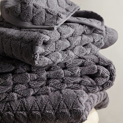 Concord Towel, Taupe - Sometimes you just need to offset all of the white or natural wood in the bathroom. These charcoal towels are chunky and offer great texture. They also look super plush and comfortable.