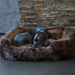 Frontgate - Animals Matter Shag Pet Lounger - Handmade. Removable pillow is stuffed with upholstery-grade, memory-spring poly fiberfill. Microsuede bottom. Zipper closure. Available in Black, Camel, Chocolate, Pink, White, White/Brown. The Animals Matter Shag Lounger Pet Bed invites your furry friend to stretch out and relax in blissful comfort. Covered in luxuriously rich faux fur, the removable pillow is generously stuffed with long-lasting upholstery-grade, memory-spring poly fiberfill.  .  .  .  .  . Machine wash . Made in the USA.