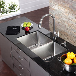 "Kraus - Kraus KPF-2170 Stainless Steel Kitchen Faucets Stainless Steel Pullout - Product Features:  Fully covered under Kraus  limited lifetime warranty 100% Stainless steel faucet body and handle construction High-quality, corrosion and rust resistant finish - finish covered under lifetime warranty Insulated pullout spray faucet head with 24"" hose Spout swivels 360 degrees to allow for unobstructed sink access Two settings: spray and stream High-arch gooseneck spout further allows for unobstructed sink access  Product Technologies and Benefits:  Precision Kerox Cartridges: The cartridge's job is to deliver smooth handle operation and water flow, throughout hundreds of thousands of uses, without ever leaking – all while under a punishing 60 pounds-per-square-inch of pressure. For these reasons, it is quite literally what ""makes or breaks"" the faucet. Kraus understands this, so they take no shortcuts here, importing their cartridges from the world's leading manufacturer of high-end precision ceramic disc cartridges, Kerox in Hungary. Swiss-Made NeoPerl Aerators: Aerators are possibly the most under-appreciated component within faucets. Not only do they soften the stream (preventing splashing), but they also control the straightness, diameter, overall delivery of water. Fortunately, like their cartridges, Kraus recognizes this and chooses to takes no gambles here – they import their aerators from NeoPerl in Switzerland, the world's leading manufacturer for high-end and specialty aerators. Heavily Certified: Kraus has gone to great lengths to be able to provide you, the homeowner, the rest-easy satisfaction knowing that your faucet is certified and listed by all the major product testing boards in the U.S. and Canada. This means that this faucet is deemed safe to use and that it meets all applicable"