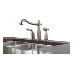 Delta - Victorian Single Handle Kitchen Faucet with Spray and Diamond Seal Techonology - Delta 155-SS-DST Victorian Single Handle Kitchen Faucet with Spray and Diamond Seal Techonology in Stainless. Delta Faucets are a reflection of your personality � they complement you, your style, your life, the way you think, work and move throughout the day.  With design cues inspired by the fleur-de-lis, the Victorian Kitchen Collection features a classic, timeless architecture. This bold design makes a distinctive statement in the kitchen that's reminiscent of another era.  Delta's exclusive DIAMOND?� Seal Technology uses a valve with a tough diamond coating to bring you a faucet built to last up to five million uses.  Plus, it keeps the water on the inside the faucet out of contact with potential metal contaminants. With its durable components and simple construction, a DIAMOND?� Seal Technology faucet lasts 10 times longer than the industry standard.  Available in multiple finishes the Victorian Collection delivers a high level of durability and performance that can be trusted for years to come.Delta 155-SS-DST Victorian Single Handle Kitchen Faucet with Spray and Diamond Seal Techonology in Stainless, Features:Diamonds are the hardest substance known to man, and DIAMOND?� Seal Technology takes full advantage of this property. Delta's exclusive DIAMOND?� Seal Technology uses a valve with a tough diamond coating to bring you a faucet built to last up to 5 million uses � plus it keeps water inside the faucet out of contact with potential metal contaminants.
