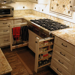 Cabinet details & specialty cabinets - Pull-out spice storage and pull-out towel rack