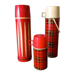 """Pre-owned Vintage Red Thermos - Set of 3 - Looking for a few fun """"made in the USA"""" accessories for your home, office or bunkhouse? This set of three, red vintage thermos containers is sure to fill that void. The two tartan plaid included in this set are authentic Thermos brand containers in a 9 oz and 1 quart size. They were made in Norwich, Conn., USA! These two feature the glass inner vaccum bottle. Smaller measures 2.75""""w x 7"""" h and the larger 3.25""""w x 13.5""""h. The other tall, striped yet oh so brilliant thermos, is made by Universal out of New Britain, Conn., USA. This particular thermos has a crack in the plastic on the bottom, but is still absolutely charming as an accessory and sits perfectly level. (Campbell's soup not included!)"""