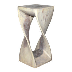 Kammika - Twist Stool Sust Wood 12 x 12 x 26 inch Ht w Eco Friendly Agate Grey Oil Finish - Our Sustainable Monkey Pod Wood Twist Stool 12 inch x 12 inch x 26 inch height with eco friendly, natural Livos Agate Grey Oil Finish is hand carved from sustainable wood and completely eco-friendly. The beauty of this design lies in its simplicity; it is bold, yet gentle, rustic, yet refined. One quarter twists support this elegant piece, which can serve as an end table, display stand, or stool. Carved from a single piece of Monkey Pod wood, these eco friendly functional art pieces are appealing to the viewer from any angle. The oil makes the wood turn to an antique white look with a light grey patina finish. The light portions of wood turn to shades of beige, and the dark wood lightens to shades of brown with a light transparent grey top coat over the white antique looking undercoat. There is no oily feel and cannot bleed into carpets, as it contains natural lacs. Made from the branches of the quick-growing Acacia tree in Thailand, where each branch is cut and carved to order (allowing the tree to continue growing), the wood is dried, carved and sanded creating a beautiful, sturdy and sustainable place to sit. We make minimal use of electric hand sanders in the finishing process. All products are dried in solar or propane kilns. No chemicals are used in the process, ever. All products finished by hand rubbed oils. After each eco friendly piece is carved, kiln dried, sanded, and hand rubbed with eco friendly, natural Livos Oil, they are packaged with cartons from recycled cardboard with no plastic or other fillers. As this is a natural product, the color and grain of your piece of Nature will be unique, and may include small checks or cracks that occur when the wood is dried. Sizes are approximate. Products could have visible marks from tools used, patches from small repairs, knot holes, natural inclusions or holes. There may be various separations or cracks on your piece wh