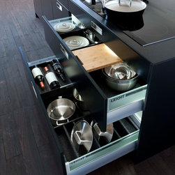 Kitchen Storage, Leicht Collection 2015 - Black oak with metal applications – classy materials and modern design even inside the drawers and pullouts. Every kitchen utensil has