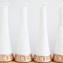 Milk Glass and Rose Gold Vases by Falcon and Finch - Look for vintage items done in rose gold — like these milk glass vases with rose gold trim.