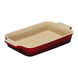 Le Creuset - Le Creuset Stoneware 7-by-10.5-Inch Rectangular Baking Dish - Le Creuset stoneware dishes are versatile, multipurpose designs that offer all the even-heating benefits of stoneware in a variety of shapes and capacities to fit nearly any baking, roasting or broiling recipe. Each dish features grooved handles for a sure grip, plus Le Creusets glazed interior that protects against utensil damage, staining and odor absorption  making each dependable piece of stoneware easy to use and easy to count on.