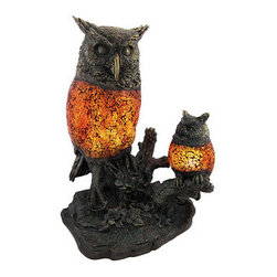 Brown and Amber Crackle Glass Double Owl Accent Lamp - This double owl accent lamp offers the beauty of a lovely decorative sculpture during the day. At night, it provides pleasant illumination for your home from the brown, red and amber glass of the owls' bodies.