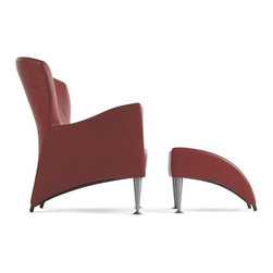 Montis; easy chair Castor - The Castor translates opulent, old-fashioned comfort into an elegant new shape. From a narrow base, the back fans out into a curved 'collar', this completely surrounds the user at the back and sides. Castor is made of moulded foam and therefore guarantees the retention of form. The additional ottoman continues the shape of the Castor fluently; therefore the 2 elements can be combined perfectly.