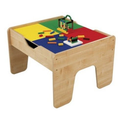 KidKraft 2 in 1 Table with Lego Compatible Board - Elevate playtime with the KidKraft 2-in-1 Table with LEGO-Compatible Board. This sturdy wood table is topped by a two-sided brightly colored surface where the busy young engineers in your life can build towering structures on a level surface. Combined with ample storage under the play board this raised table keeps toys tidy contained and off the floor. Large enough to play with friends this versatile table comes with 200 blocks and a 30-piece train set for hours of inventive fun. About KidKraftKidKraft is a leading creator manufacturer and distributor of children's furniture toy gift and room accessory items. KidKraft's headquarters in Dallas Tex. serves as the nerve center for the company's design operations and distribution networks. With the company mission emphasizing quality design dependability and competitive pricing KidKraft has consistently experienced double-digit growth. It's a name parents can trust for high-quality safe innovative children's toys and furniture.