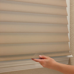 Silhouette - Closed, the fabric vanes allow you privacy while maintaining the soft, elegant style Silhouette window shadings create. Optional LiteRise® operating system raises, lowers and tilts shading without cords.