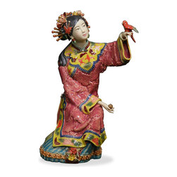 China Furniture and Arts - Chinese Porcelain Doll - With vivid facial expression and hand gesture, this porcelain figurine in early Qing (1644) costume depicts a young lady ready to set free the spring bird on her hand.