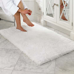 Frontgate - Belize Memory Foam Bath Rug - Thick, memory foam core provides cushioned comfort and anti-fatigue benefits. A tapered edge provides a tailored finish, while bright colors accent your bathroom decor. Continuous filament micro-polyester yarn does not lint. Safe, skid-resistant latex backing. Machine wash; extended dry time required. Our unique Belize Memory Foam Bath Rug is the softest and plushiest bath mat you'll ever sink your feet into. Ideal for use in front of a sink or vanity, the rug is made of 100% polyester fiber that is exceptionally soft, naturally stain resistant, and very durable. The open-cell technology of the memory foam repels water, thus allowing the polyester yarn to quickly wick away any moisture.  .  .  .  .  . Imported.