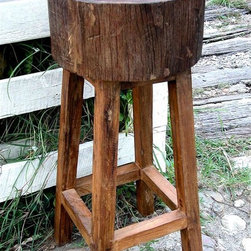 """Groovy Stuff - Rustic All-Weather Stump Seat Bar Stool in Te - Our popular teak bar stool is proof that sometimes Mother Nature's design is the best design!  Crafted of natural reclaimed teak, this environmentally friendly barstool stands 30"""" high and features a 13"""" diameter Teak tree stump seat.  In times of yesteryear, there was plenty of tree stump seating, but none quite as refined as this thick, durable bar stool.  Long legs accent the thick seat that shows off the stunningly beautiful grains of the teakwood construction with style.  Not just a bump on a log! * Our popular Teak 30"""" Stump Seat Bar Stool is proof that sometimes Mother Nature's design is the BEST design.. Crafted of natural reclaimed Teak, this environmentally friendly barstool stands 30"""" high and features a 13"""" diameter Teak tree stump seat.. LxWxH: 13 x 13 x 30 (inches). Reclaimed teakwood furniture creates this rugged rustic look. Bring a bygone era of yokes, plows wagons to your home or business. Each unique piece is suited for both indoor and outdoor use. Please Note: Due to the unique nature of each piece of wood and the materials used, no two items are exactly alike. These items can vary in dimension, weight and color from the shown image and the listed information"""